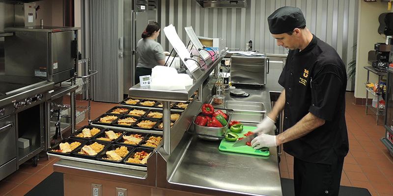 Chef Williams preparing meals
