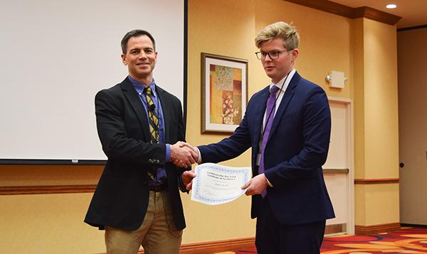 Dain Jacobs receiving award
