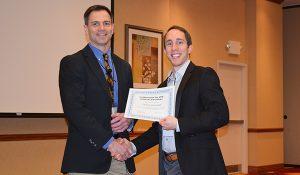 Zach Grunewald receiving award
